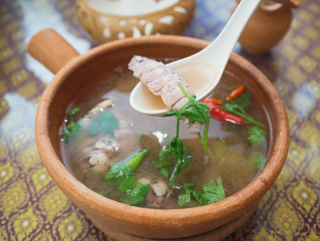 sweet and sour soup with crayfish (focus crayfish on the spoon) Stock Photo