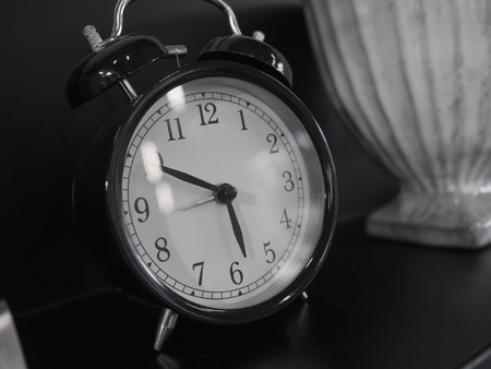 back in an hour: vintage clock in monocrome style Stock Photo