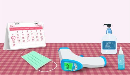 Important equipment during the epidemic control . as medical masks, hand washing gels, fever thermometer is new normal of life On Valentine's day. with Calendar marked on 14th February 2021