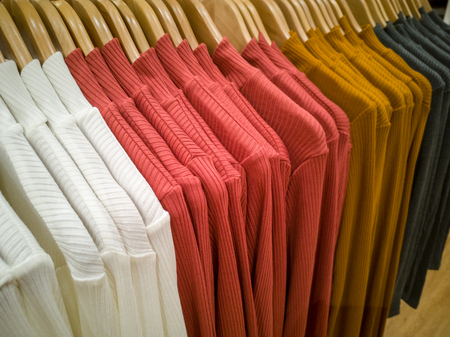 Multi-colored T-shirt hanging in the lining of the shopping mall.