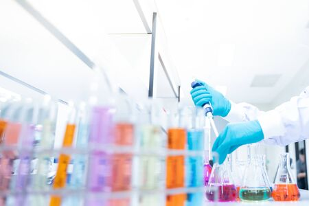 Scientific Glassware For Chemical,Laboratory Research Analysis Laboratory - Scientist With Pipette And Beaker - Equipment Chemical.shallow focus effect.