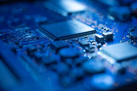 Circuit board.Motherboard digital chip. Electronic computer hardware technology.Integrated communication processor.Information engineering component.Tech science background.shallow focus effect. Stock Photo