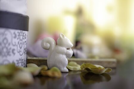White ceramic doll, rabbit Placed on the dressing table in the dressing room and makeup.soft focus. 写真素材 - 129956114