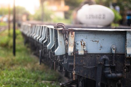 Rusty old iron freight train In the train station, Thai train stops at the station 写真素材 - 129956134