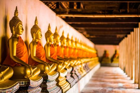 Golden Buddha of Buddhism A beautiful row in ancient buildings in Thailand. 写真素材 - 129956225