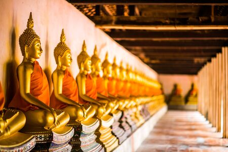 Golden Buddha of Buddhism A beautiful row in ancient buildings in Thailand. 写真素材 - 129957197