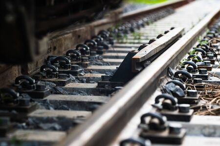 Close up Steel railroad fasteners.Iron nuts fastened to railway tracks.soft focus. 写真素材 - 129958020