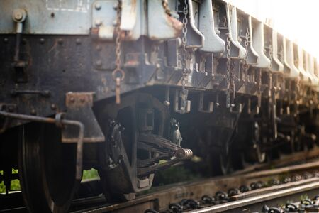 Rusty old iron freight train In the train station, Thai train stops at the station