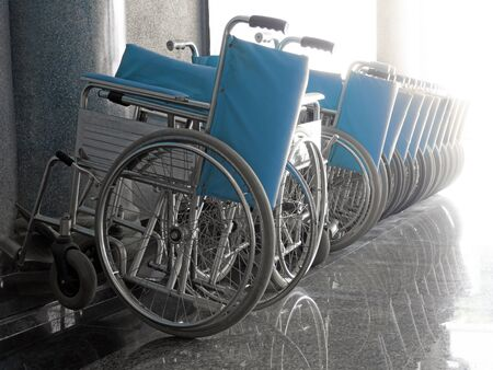 Blue Wheelchair in the hospital, wheelchair waiting for patient service, wheelchair arranged in the hospital,For those who cant walk.
