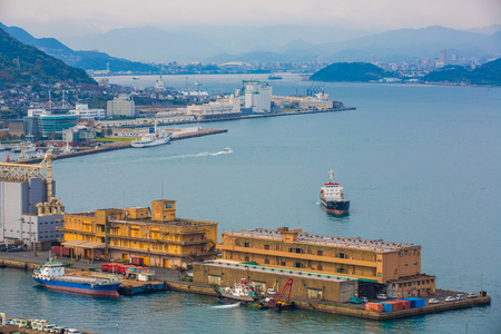 Kitakyushu, Japan - 20 November 2016 : A view of Mojiko Port, a large port city and commercial center Viewed from the Kanmon Strait and Kanmonkyo Bridge