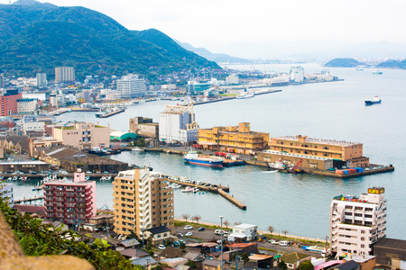 Kitakyushu, Japan - 20 November 2016: A view of Mojiko Port, a large port city and commercial center Viewed from the Kanmon Strait and Kanmonkyo Bridge Stock Photo - 129746271