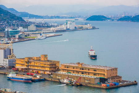 Kitakyushu, Japan - 20 November 2016: A view of Mojiko Port, a large port city and commercial center Viewed from the Kanmon Strait and Kanmonkyo Bridge