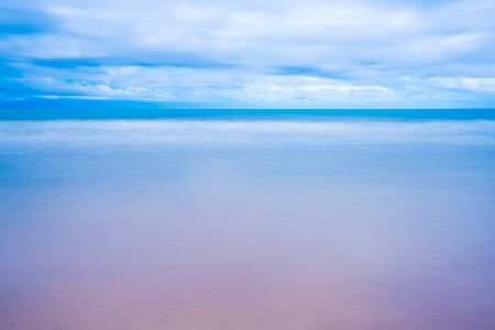 Sea landscape and sandy beach in the morning Fog against the background of a cloudy at sun rise time.Chanthaburi Coast, Thailand.soft focus. 写真素材