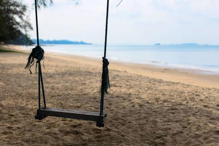 Swings on the beach.