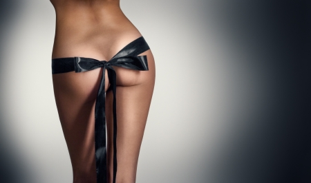 Woman bum with black ribbon photo