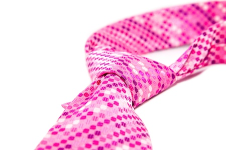 health symbols metaphors: pink cravat flyspecked on white background
