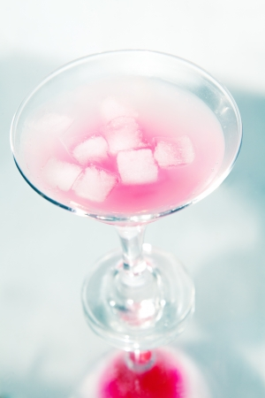 reflaction: pink cocktail with ice and reflaction in studio