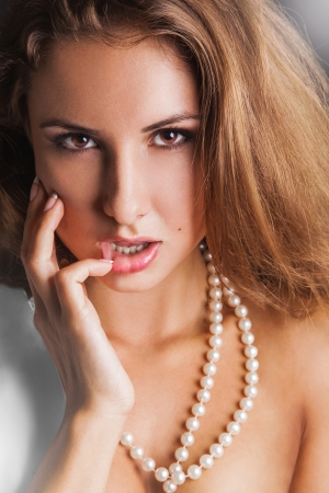 Sensual woman with brown eyes looking at camera in studio Stock Photo - 20340755