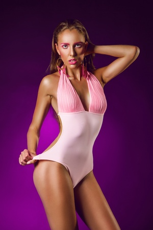 Purple background and sexy wiman on it in studio photo