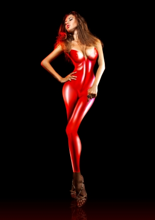Hot female in red latex in studio photo