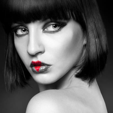 black and white portrait of brunette heart on lips in studio photo