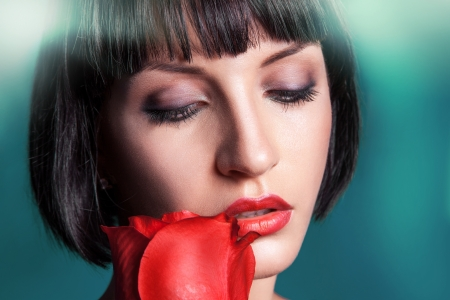Horizontal portrait of cutie brunette with red rose photo