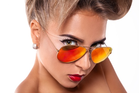 Gorgeous woman in sunglasses in studio photo