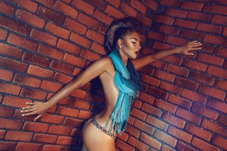 Sexy female with closed eyes near brick wall Stock Photo - 21511142