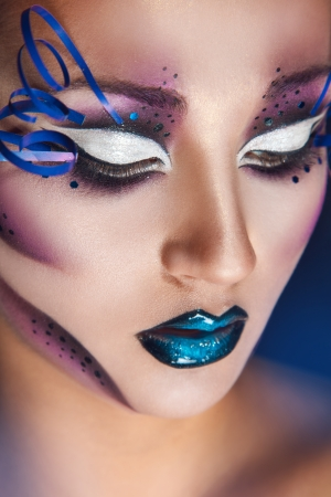 Close up portrait ofbeautiful caucasian woman with creative make up in studio photo