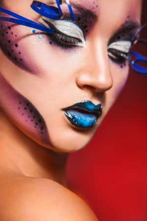 fashion portrait of sexy woman with creative make up in studio photo