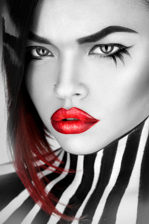 black and white Serious woman with sexy red lips looking at camera in studio Stock Photo - 25066855