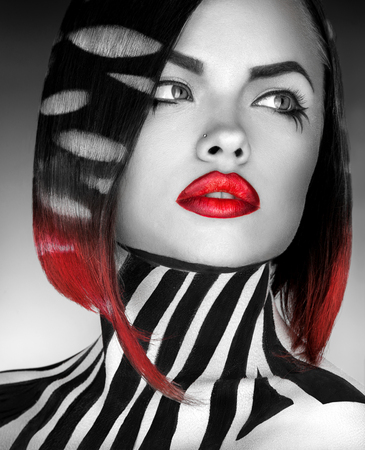 black and white photo og fashion model with stripes on body and hair in studio photo