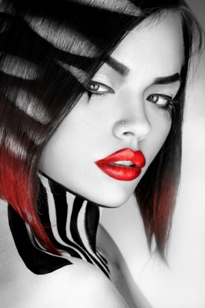 Desaturated portrait of sexy caucasian woman with red lips in studio Stock Photo - 25066862