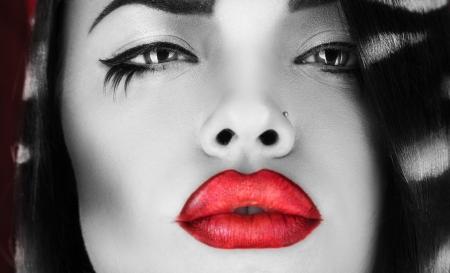 Horizontal photo of black and white female with red lips in studio photo