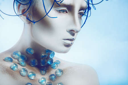Creative portrait of woman with body art in studio photo