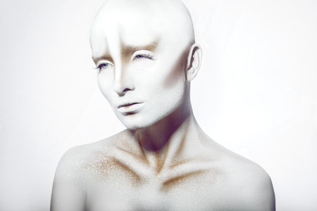 Bald woman in bodyart in studio photo