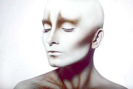Hairless woman with closed eyes in studio photo