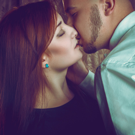 Passion in couple in studio photo
