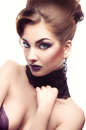 Lovely  portrait of sexual adult woman with make up and hairstyle in studio photo