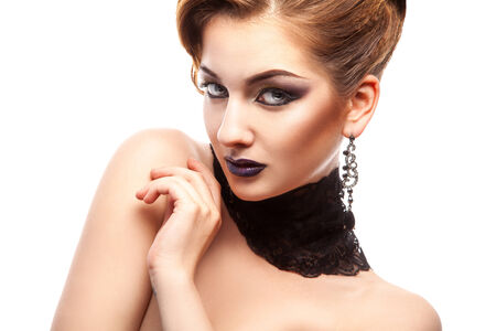 Horizontal portrait of fashion model with make up on white in studio photo