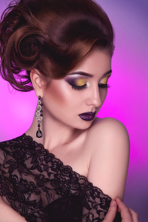 closed society: Vertical photo of elegance adult girl with creative hairstyle and make up on pink in studio