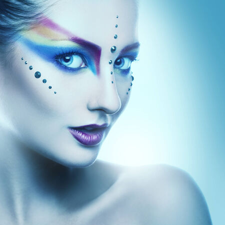 Portrait of beautiful adult woman with colorful makeup photo