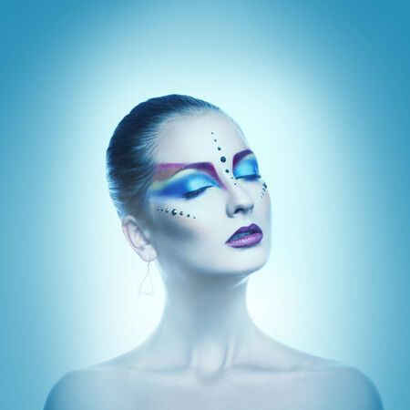 Square cold tones portrait of sexual woman with closed eyes and multicolor make up photo