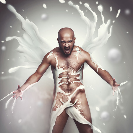 strong man in milk screaming photo