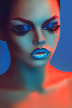 Sensual portrait of gorgeous woman with closed eyes and make up in studio photo