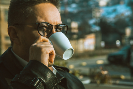 sightly: sightly man drinking coffee outdoors Stock Photo
