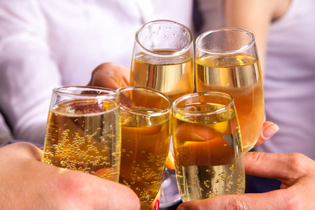 clink: celebrate and clink glasses with champagne. horizontal photo