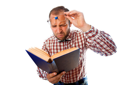 poor eyesight: Adult man with poor eyesight try to read a book on white background