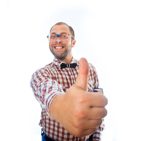 classbook: cheerful smiling geek shows class mark in studio on white background Stock Photo