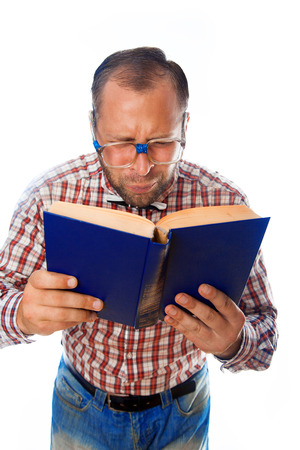 poor eyesight: geek with poor eyesight reading a book on white background